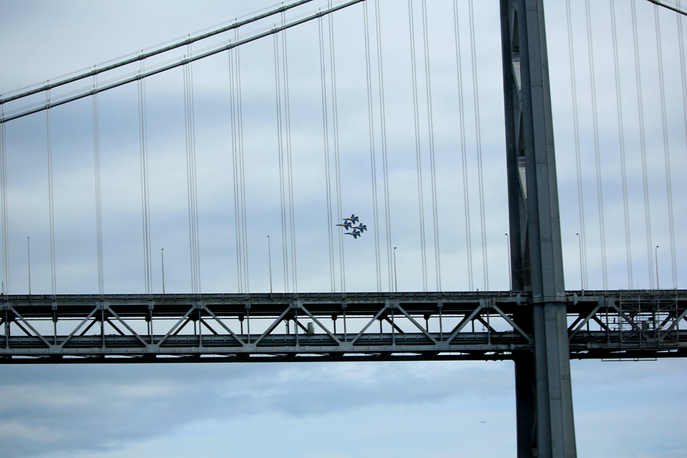 Blue Angels flying behind the Bay Bridge in San Francisco during Fleetweek 2012