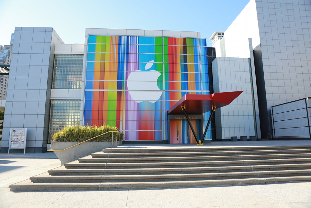 Apple logo, white with color background for Sep 12 -2012 event in San Francisco