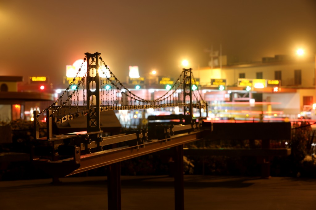 Model of Golden Gate Bridge at night with Toll Plaza in background